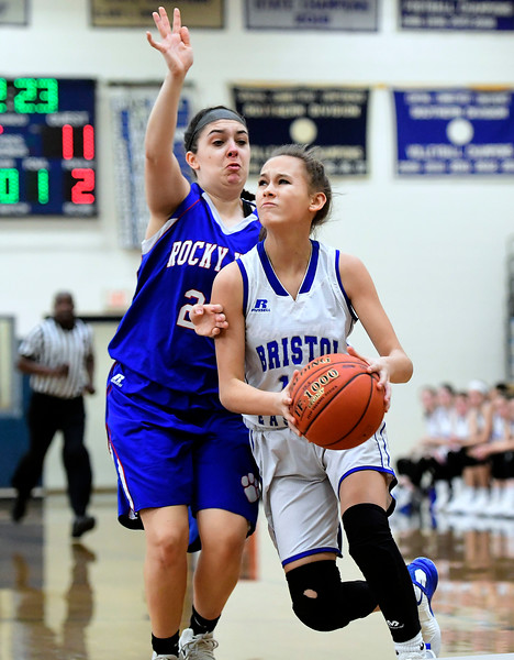 2/9/2019 Mike Orazzi | Staff Bristol Eastern's Cali Doyon (12) and Rocky Hill's 	Aleksa Peterson (25) during Saturday's girls basketball game in Bristol.