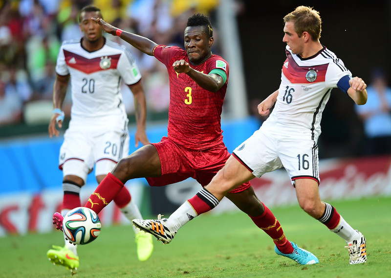 . Germany\'s defender and captain Philipp Lahm (R) vies with Ghana\'s forward and captain Asamoah Gyan during a Group G football match between Germany and Ghana at the Castelao Stadium in Fortaleza during the 2014 FIFA World Cup on June 21, 2014.  (JAVIER SORIANO/AFP/Getty Images)
