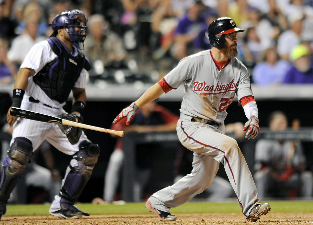 . Washington Nationals first baseman Adam LaRoche hits a three-run home run in the seventh inning of a baseball game against the Colorado Rockies on Tuesday, July 22, 2014, in Denver. (AP Photo/Chris Schneider)