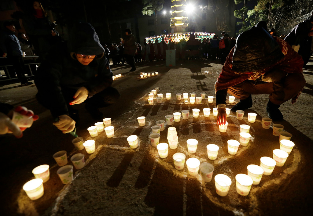 . Buddhists place candles during New Year celebrations at Jogye Buddhist temple in Seoul, South Korea, Thursday, Jan. 1, 2015. (AP Photo/Ahn Young-joon)