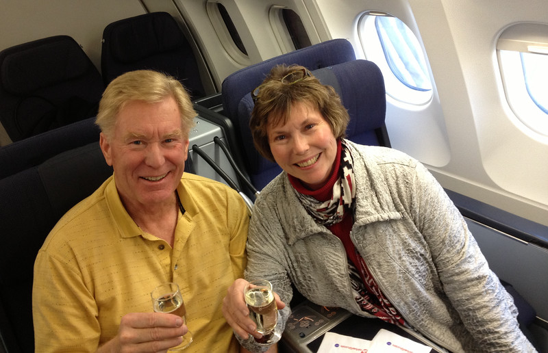 Toasting to a business class flight is part of a luxury trip.