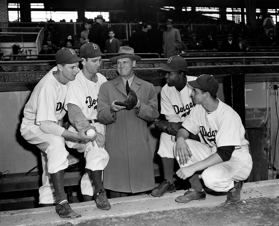 . Brooklyn Dodgers new first base coach George Sisler, center, talks with four Dodgers first basemen, from left, Howie Schultz, Ed Stevens, Jackie Robinson, and Tom Brown, at Ebbets Field in Brooklyn, N.Y., April 23, 1947.  Sisler is the former St. Louis Browns first baseman.  (AP Photo)