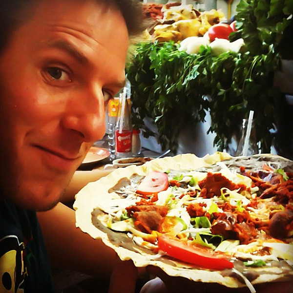 Giant tlayuda covered with beans, chorizo, avocado & Oaxacan cheese. Oh my! #oaxaca