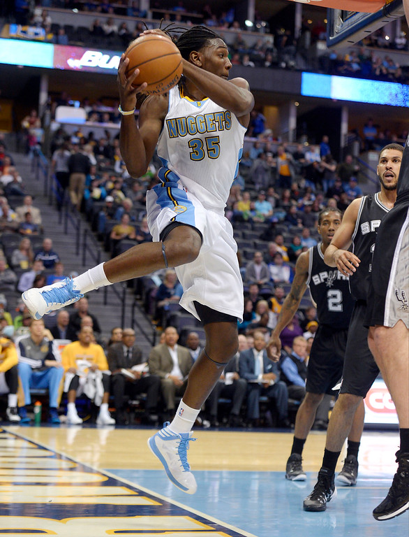 . DENVER, CO - OCTOBER 14: Denver Nuggets small forward Kenneth Faried (35) leaps out of bounds to save the ball against the San Antonio Spurs October 14, 2013 at Pepsi Center. (Photo By John Leyba/The Denver Post)