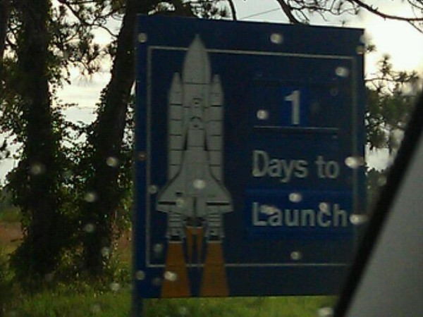 Signs at Kennedy Space Center show one day until launch
