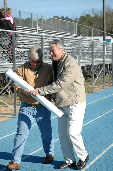 Frank gets to work right away with Special Olympics Leon County Coordinator Donnie Jacobs.