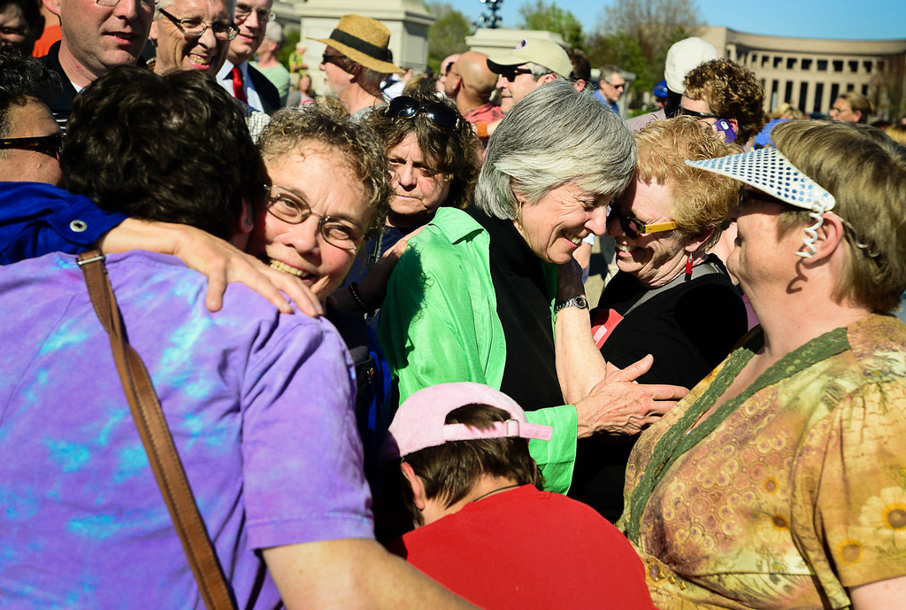 . Rep. Karen Clark, DFL-Minneapolis, center right, and her partner, Jacquelyn Zita, left, were congratulated as they made their way to the steps of the state Capitol, where Gov. Mark Dayton signed the Freedom to Marry bill. (Pioneer Press: Ben Garvin)