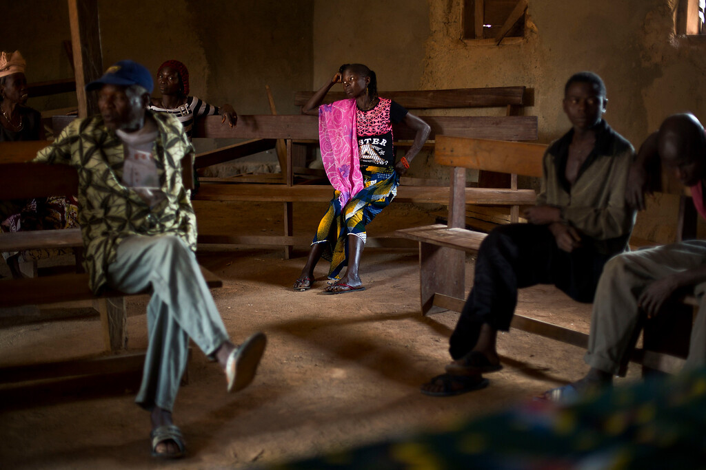 . In this photo taken Thursday Nov. 20, 2014, residents listen to the village chief in the communal room in the Guinean village of Meliandou, some 400 miles (600 mms) south-east of Conakry, Guinea, believed to be Ebola\'s ground zero. (AP Photo/Jerome Delay)