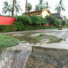 Rainwater Flowing From Road onto Beach