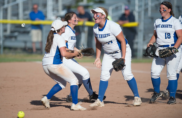 06/03/19 Wesley Bunnell | Staff Southington softball defeated Trumbull in a semifinal Class LL game at DeLuca Field in Stratford on Monday afternoon. Nicole Greco (4) and Kelsey Fernandez (1) are met by teammates including Abby Lamson (17) after Greco caught a fly ball for the last out of the game.
