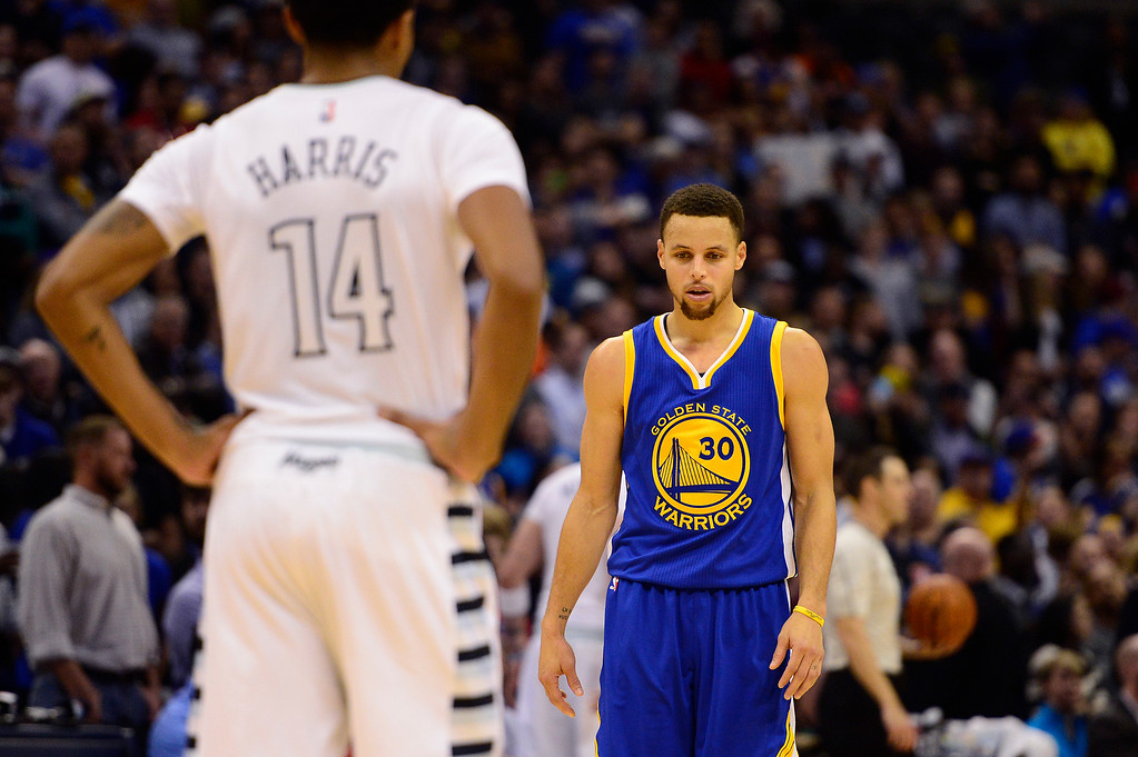 . DENVER, CO - JANUARY 13: Stephen Curry (30) of the Golden State Warriors waits the start of the next play to defend Gary Harris (14) of the Denver Nuggetsduring the second half at the Pepsi Center on January 13, 2016 in Denver, Colorado. The Nuggets defeated the Warriors 112-110, giving the Warriors their third loss of the season. (Photo by Brent Lewis/The Denver Post)
