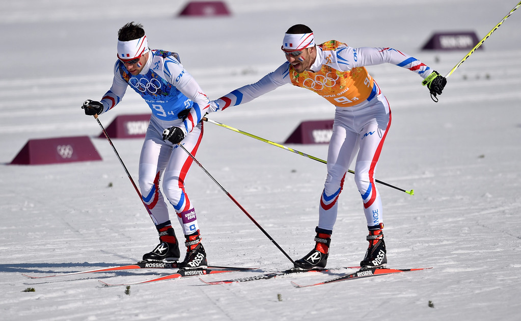 . Bronze medalists Ivan Perrillat Boiteux (L) and Robin Duvillard of France in action during the Men\'s 4 X 10km Relay competition at the Laura Cross Country Center during the Sochi 2014 Olympic Games, Krasnaya Polyana, Russia, 16 February 2014.  EPA/HENDRIK SCHMIDT