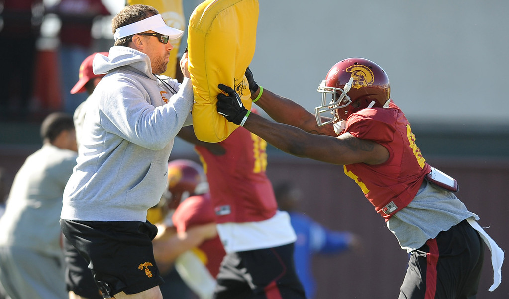 . Pads are used for a drill during USC\'s spring practice Monday, April 1, 2014. (Andy Holzman/Los Angeles Daily News)