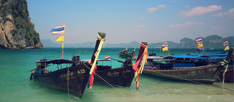Longtail boats in a row in Krabi