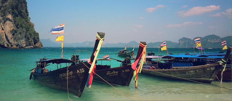 Longtail boats in a row in Krabi