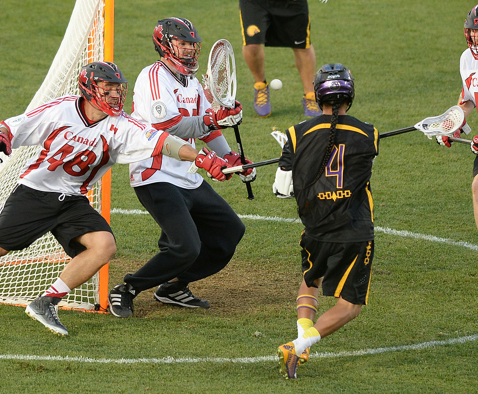 . COMMERCE CITY, CO - JULY 17: Iroquois attack Lyle Thompson (4) beat Canada goalie Dillon Ward (37) in the first quarter. The Iroquois Nationals took on Canada in a FIL World Championship semifinal game Thursday night, July 17, 2014.  Photo by Karl Gehring/The Denver Post