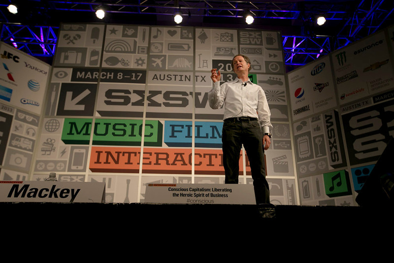 """. John Mackey, co-CEO of Whole Foods, speaks during a session titled \""""Conscious Capitalism: Liberating the Heroic Spirit of Business: at the SXSW Interactive Festival in Austin on Sunday, March 10, 2013. (AP Photo/Austin American-Statesman, Deborah Cannon)"""