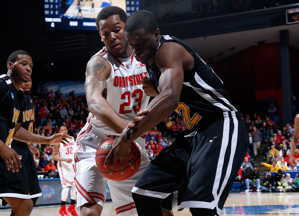 . DAYTON, OH - MARCH 22: Amir Williams #23 of the Ohio State Buckeyes and Sean Armand #22 of the Iona Gaels fight for the ball in the second half during the second round of the 2013 NCAA Men\'s Basketball Tournament at UD Arena on March 22, 2013 in Dayton, Ohio.  (Photo by Joe Robbins/Getty Images)