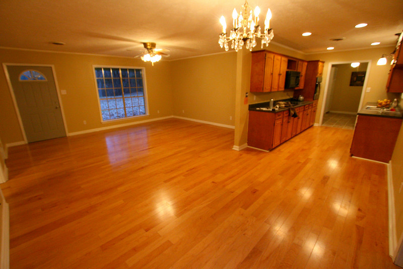 Open floor plan, 100% solid wood floors glued down. Beautiful open living room with 3 layers of trim, crown molding, base and shoe molding makes this room elegant!