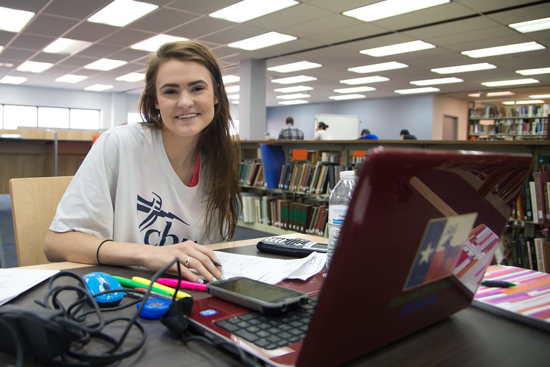 Victoria Hines works on her Biomedical Science assignment at the Mary and Jeff Bell Library.