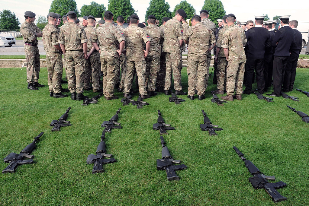. British soldiers stand next to their weapons placed on the ground, in front of Bayeux\'s war cemetery, northern France, on June 5, 2014, a day before the start of the D-Day commemorations. AFP PHOTO / JEAN-FRANCOIS  MONIER/AFP/Getty Images