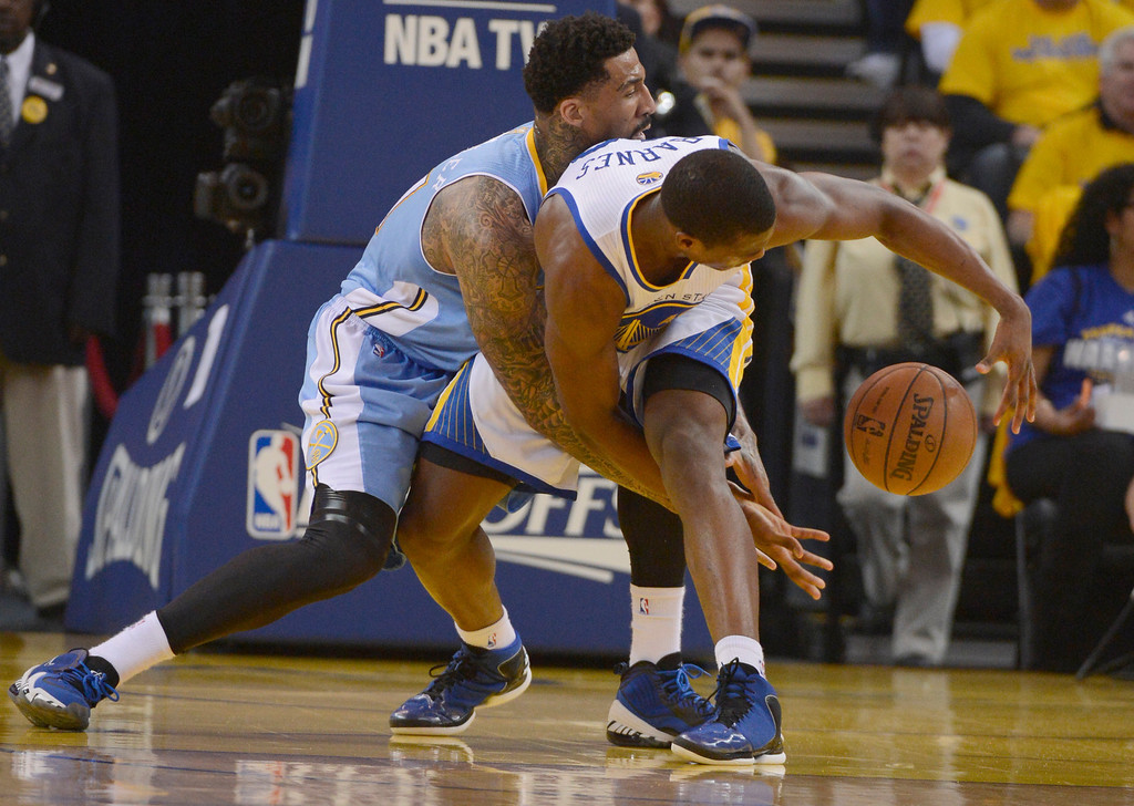 . OAKLAND, CA. - APRIL 26: Wilson Chandler (21) of the Denver Nuggets wraps up Harrison Barnes (40) of the Golden State Warriors as he goes for the ball during the first quarter in game 3 of the first round of the NBA Playoffs April 26, 2013 at Oracle Arena.  (Photo By John Leyba/The Denver Post)