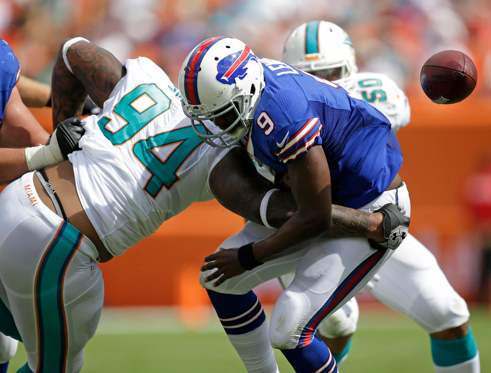 . Miami Dolphins defensive tackle Randy Starks (94) sacks Buffalo Bills quarterback Thad Lewis (9) as he fumbles the ball during the first half of an NFL football game, Sunday, Oct. 20, 2013, in Miami Gardens, Fla. (AP Photo/Wilfredo Lee)