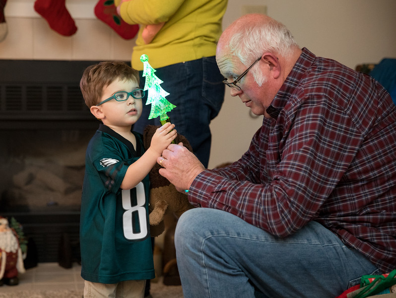 Pap and Caleb with Christmas Tree glowstick.jpg