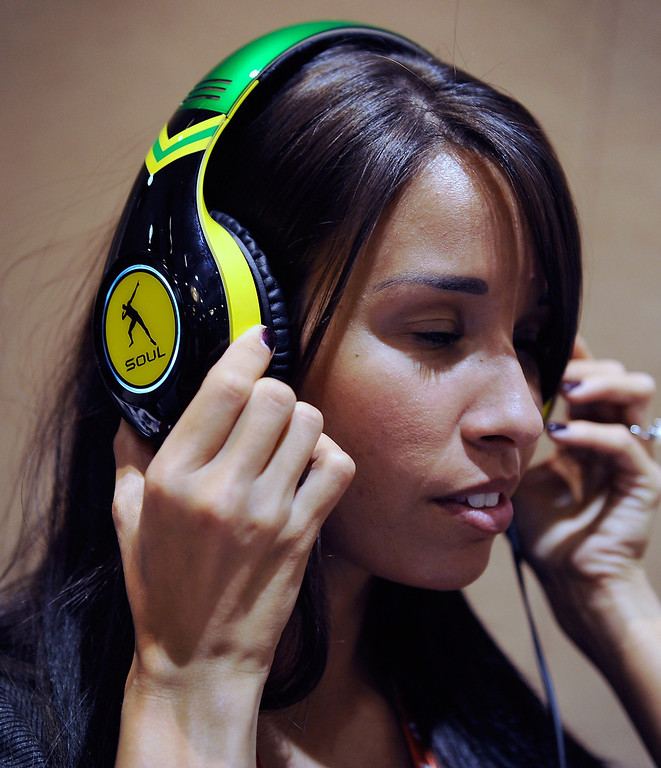 . Shauna Cyr wears a pair of USD 299 Soul SL300 noise-cancelling headphones at a press event at the Mandalay Bay Convention Center for the 2013 International CES on January 6, 2013 in Las Vegas, Nevada. (Photo by David Becker/Getty Images)