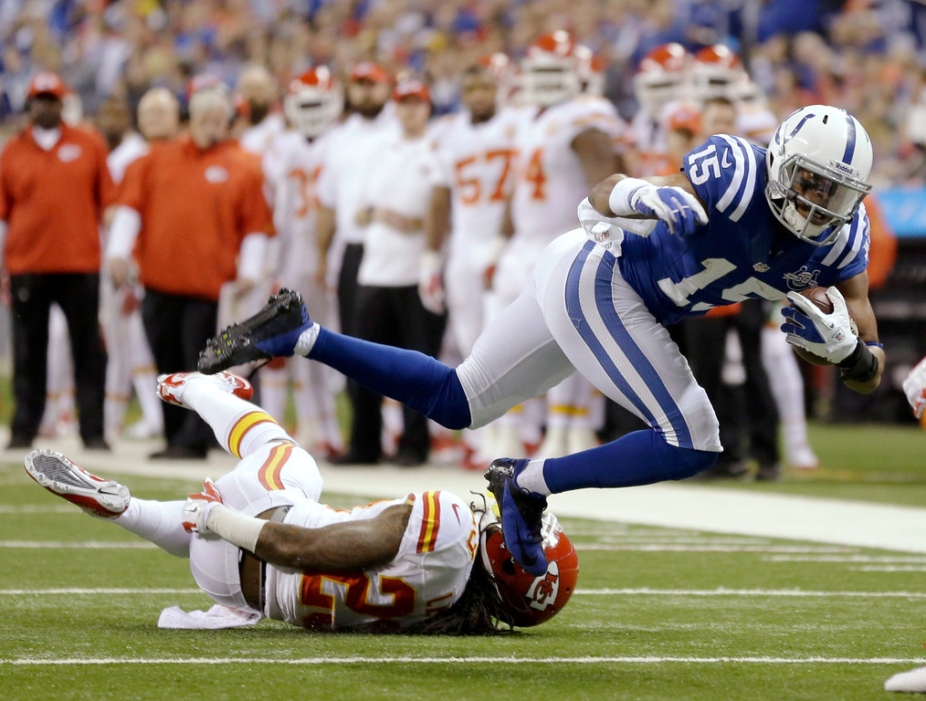 . Indianapolis Colts wide receiver LaVon Brazill (15) is tackled by Kansas City Chiefs free safety Kendrick Lewis (23) during the first half of an NFL wild-card playoff football game Saturday, Jan. 4, 2014, in Indianapolis. (AP Photo/Michael Conroy)
