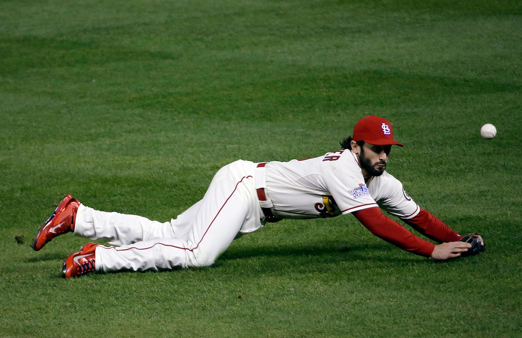 . St. Louis Cardinals\' Matt Carpenter can\'t catch a ball hit by Boston Red Sox\'s Jacoby Ellsbury during the fourth inning of Game 3 of baseball\'s World Series Saturday, Oct. 26, 2013, in St. Louis. (AP Photo/David J. Phillip)