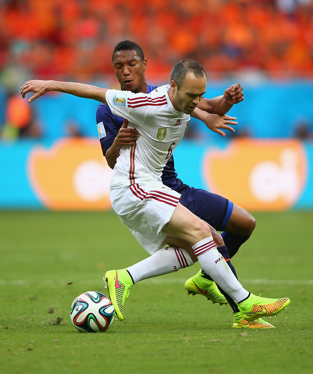 . Andres Iniesta of Spain holds off a challenge by Jonathan de Guzman of the Netherlands during the 2014 FIFA World Cup Brazil Group B match between Spain and Netherlands at Arena Fonte Nova on June 13, 2014 in Salvador, Brazil.  (Photo by Ian Walton/Getty Images)