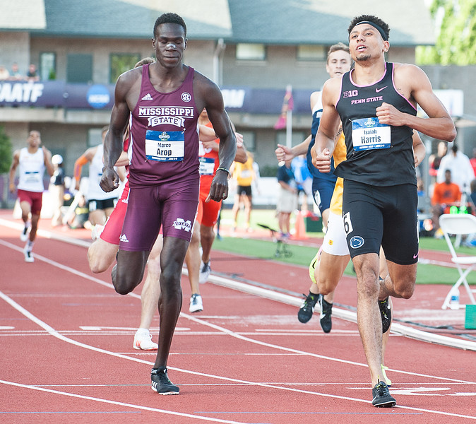 Penn State Junior and former Lewiston High School standout Isaiah Harris crosses the finish line ahead of  Mississippi State's Marco Arop during his 800 meter semifinal heat at Hayward Field in Eugene, Oregon Wednesday night.  He won his heat with a time of 146.99 to advance to Friday night's finals in the NCAA Division 1 Track and Field Championships.  (Russ Dillingham/Sun Journal)