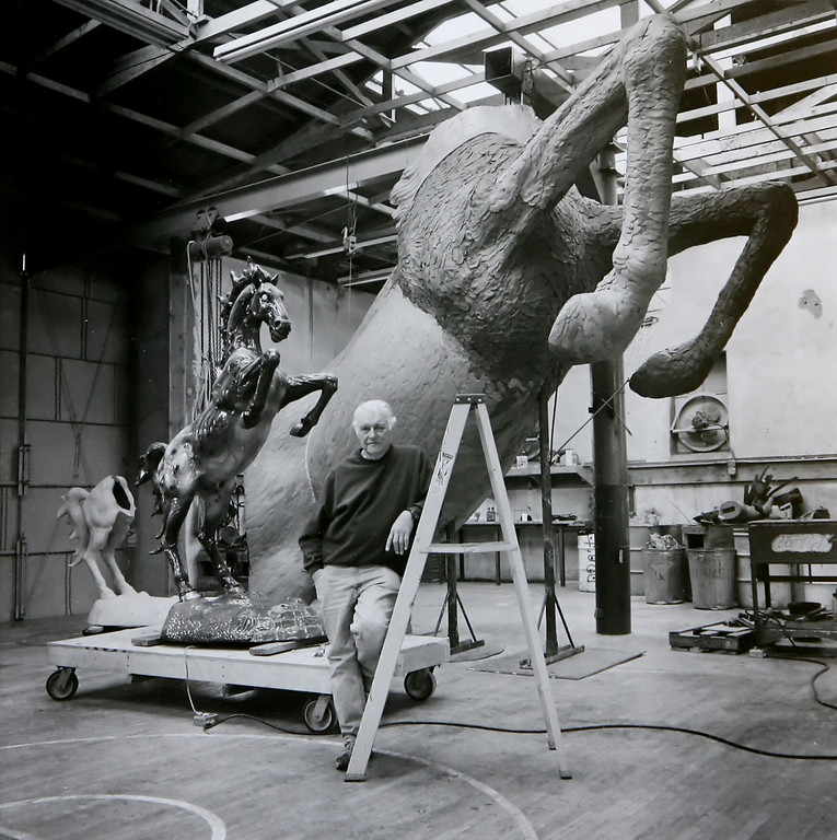 """. Sculptor Luis Jimenez, shown in March 2003 at his Hondo, N.M. studio with the mockette sculpture \""""Mustang\"""" along with the larger piece commissioned for display at the Denver International Airport.  Jimenez, a successful but often controversial sculptor whose work has been displayed at the Smithsonian and the Museum of Modern Art, died Tuesday, June 13, 2006, in what authorities are calling an industrial accident. (AP Photo/Dick George via The Corpus Christi Caller-Times)"""