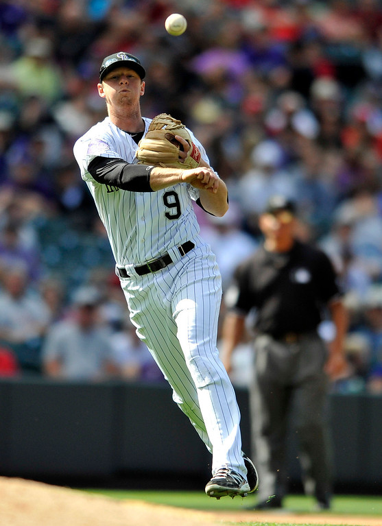 . Colorado Rockies second baseman DJ LeMahieu throws out St. Louis Cardinals\' David Freese at first during the sixth inning of a baseball game on Thursday, Sept. 19, 2013, in Denver. (AP Photo/Jack Dempsey)