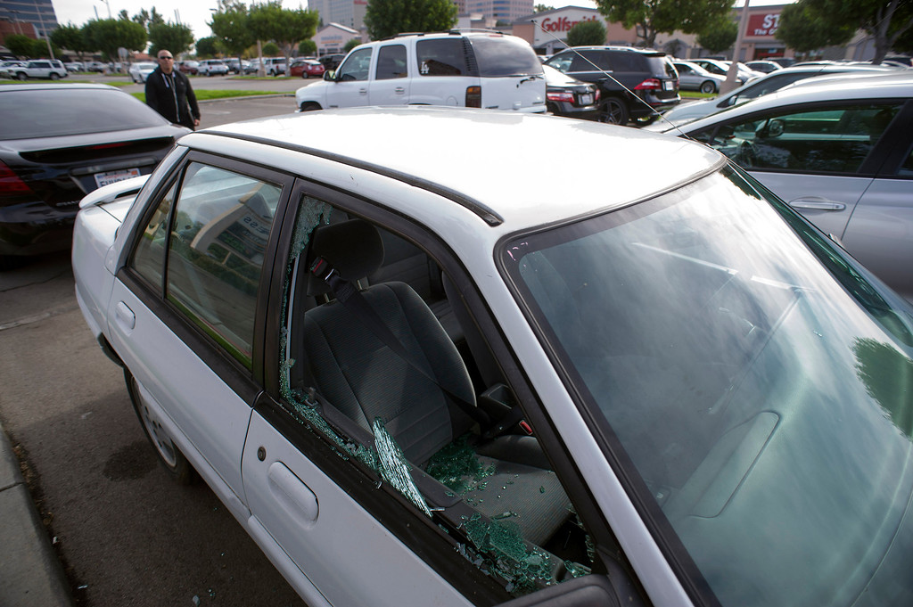 . A  car window  was broken to demonstrate how quickly thieves can steal your belongings during a press conference in Woodland Hills Monday, December 2, 2013. The event was held to to help people avoid becoming a victim of car burglary this holiday shopping season. (Photo by Hans Gutknecht/Los Angeles Daily News)
