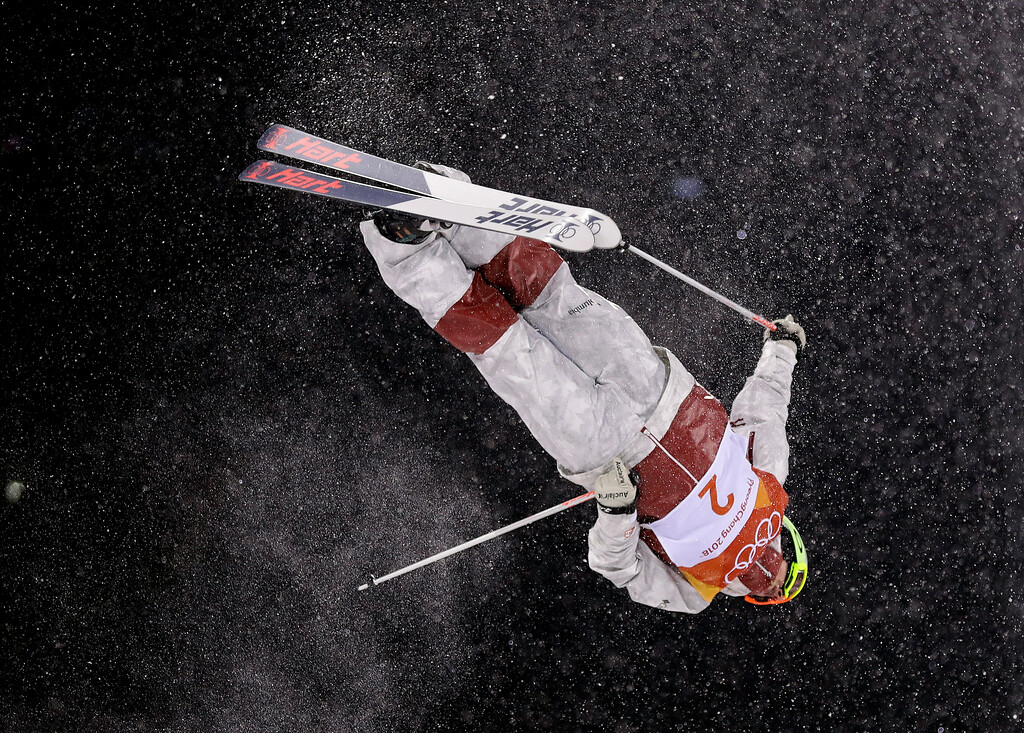 . Andi Naude, of Canada, jumps during the women\'s moguls finals at Phoenix Snow Park at the 2018 Winter Olympics in Pyeongchang, South Korea, Sunday, Feb. 11, 2018. (AP Photo/Gregory Bull)