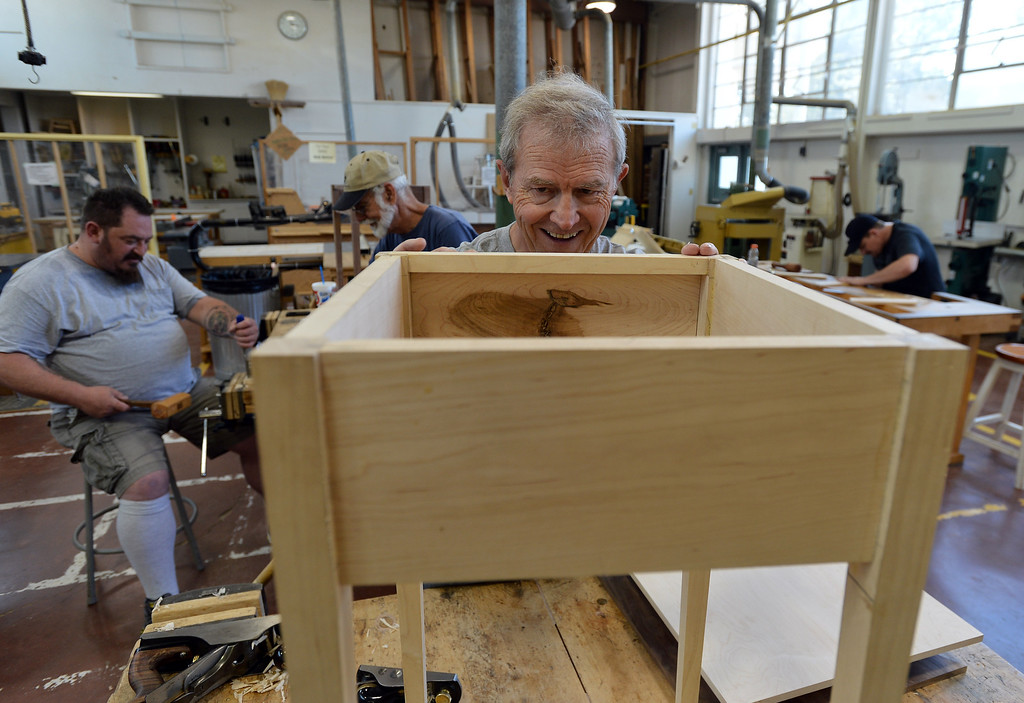 . Diablo Woodworkers instructor David Lipscomb test fits a drawer piece in Pleasant Hill, Calif. on Wednesday, July 24, 2013. The Diablo Woodworkers are reaching out to military veterans and emphasizing the therapeutic qualities of woodworking. (Kristopher Skinner/Bay Area News Group)