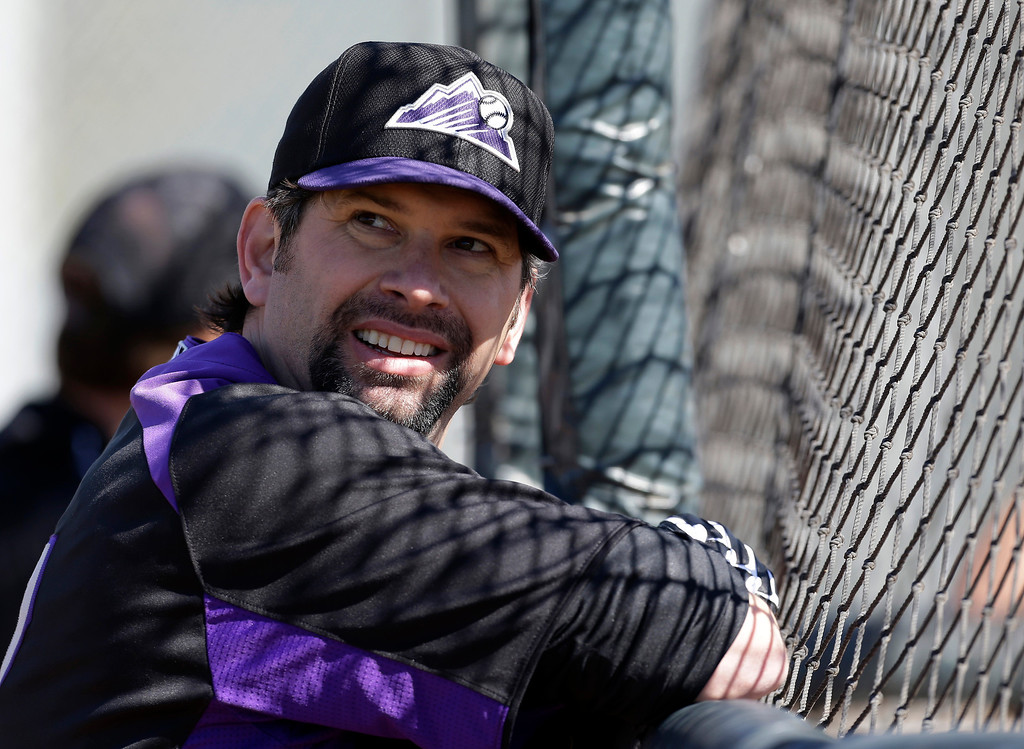 . Colorado Rockies\' Todd Helton watches batting practice during a spring training baseball workout Sunday, Feb. 17, 2013, in Scottsdale, Ariz. (AP Photo/Darron Cummings)