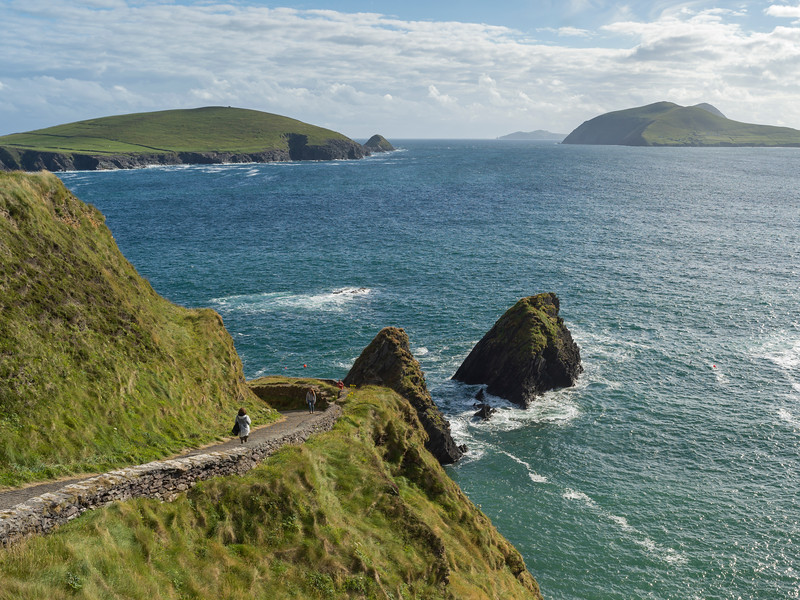 Hikers on mountain road, Ballyferriter, County Kerry, Ireland