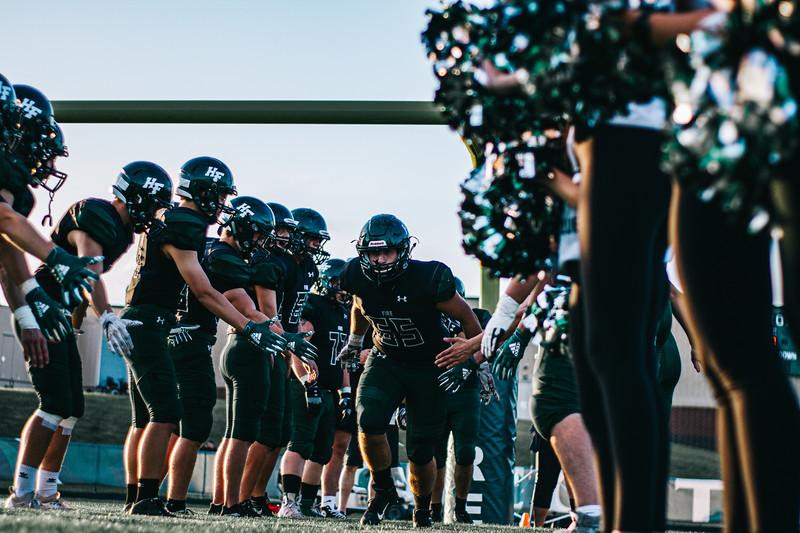Holy Family Varsity Football vs. Dassel-Cokato, 9/6/19: Captain Mark Roane '20 (65)
