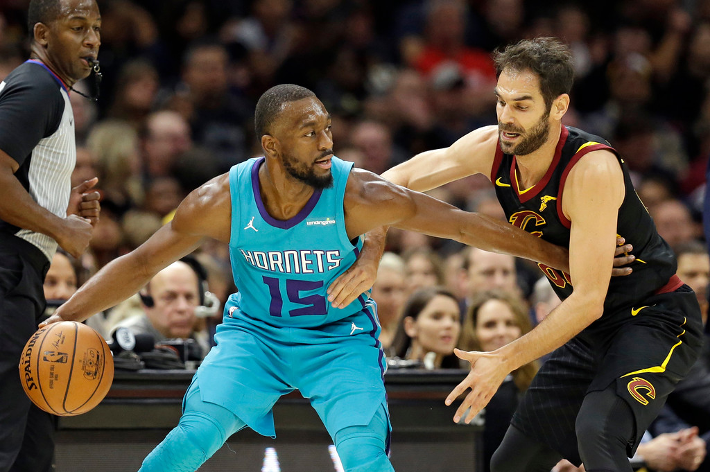 . Charlotte Hornets\' Kemba Walker, left, drives against Cleveland Cavaliers\' Jose Calderon, from Spain, in the first half of an NBA basketball game, Friday, Nov. 24, 2017, in Cleveland. (AP Photo/Tony Dejak)