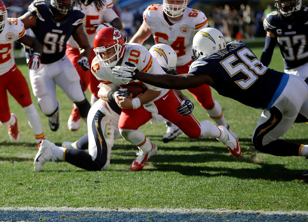 . Kansas City Chiefs quarterback Chase Daniel  (10) pushes towards the end zone but can\'t quite get in as San Diego Chargers inside linebacker Donald Butler (56) and inside linebacker Manti Te\'o, behind, haul him down during the first half in an NFL football game, Sunday, Dec. 29, 2013, in San Diego. (AP Photo/Lenny Ignelzi)
