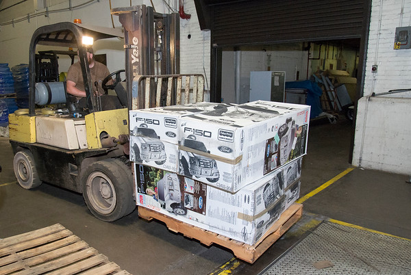 07/11/19 Wesley Bunnell | Staff A forklift inside of 1 Hartford Square picks up a pallet of toy cars on Thursday morning. Approximately 300 toy cars were donated and delivered by Fisher-Price to expand the Go Baby Go! program which is a learning project between New Britain High School and CCSU students in the technology fields. The program helps children with limited mobility by modifying toy cars for the exact needs of each child.
