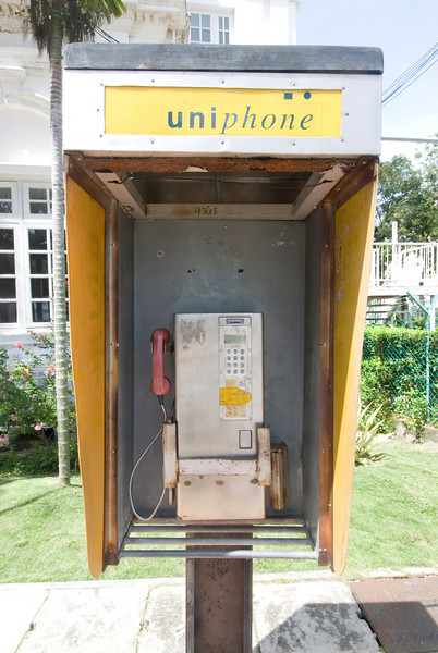 Solitary phone booth spotted on a side street in George Town, Penang, Malaysia