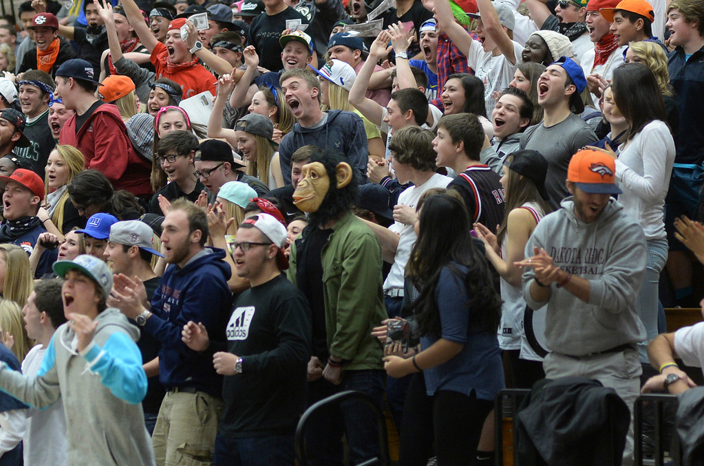 . LITTLETON, CO. - JANUARY 17: Dakota Ridge fans cheered a spectacular play in the first half. The Dakota Ridge High School boy\'s basketball team hosted Chatfield Friday night, January 17, 2014. Photo By Karl Gehring/The Denver Post