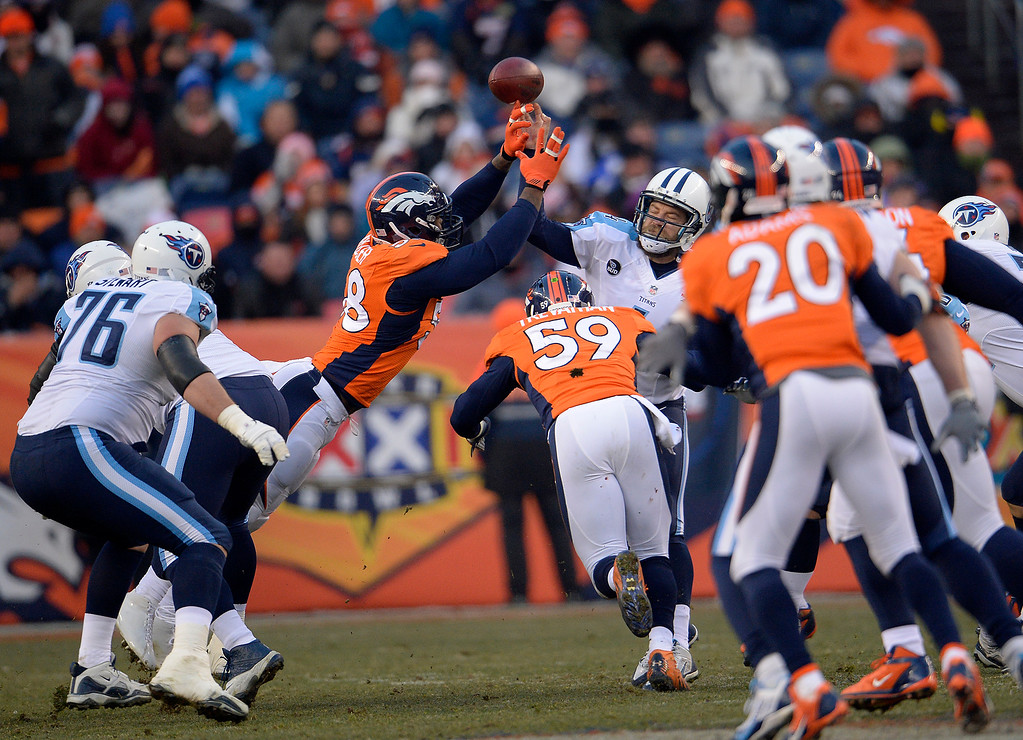 . Denver Broncos outside linebacker Von Miller (58) tips the pass by Tennessee Titans quarterback Ryan Fitzpatrick (4) causing an interception.   (Photo by Joe Amon/The Denver Post)