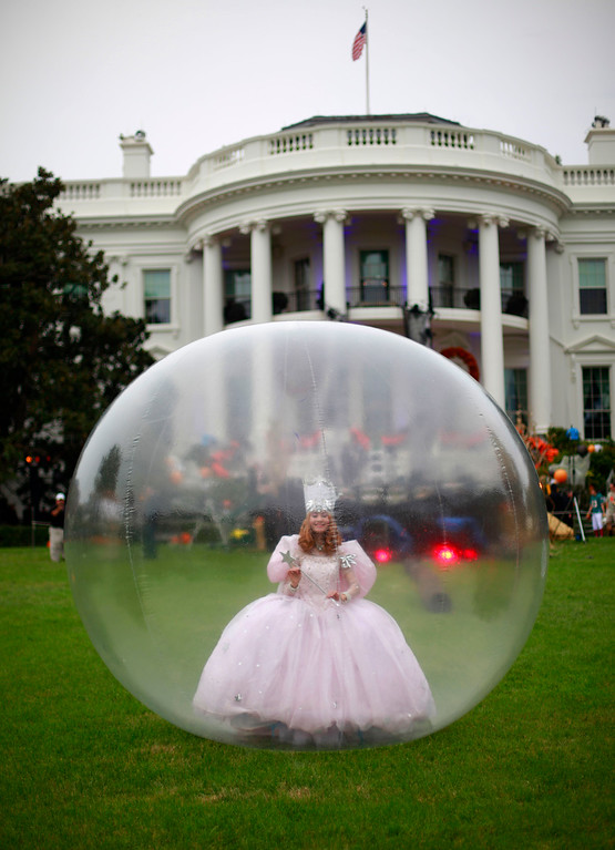 . A actress dressed as Glinda, the Good Witch of the North from the movie \'Wizard of Oz\' is seen on the South Lawn of the White House in Washington, Thursday, Oct. 31, 2103, as preparation are finalized for trick-or-treaters. President Barack Obama and first lady Michelle Obama will welcome local children and children of military families to \'trick-or-treat\' at the White House for Halloween. The White House canceled its Halloween celebration last year in aftermath of Superstorm Sandy. (AP Photo/Pablo Martinez Monsivais)