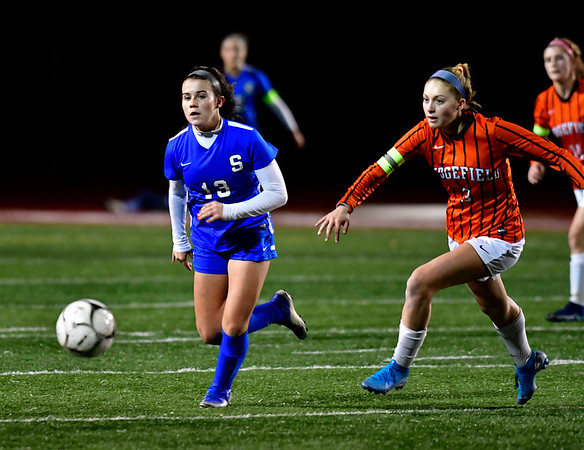 11/19/2019 Mike Orazzi | StaffrSouthington High Schools Maya Wroblewski (13) and Ridgefield's Carolyn Donovan (3) during the Class LL Semifinal Girls Soccer match at Naugatuck High School Tuesday night.