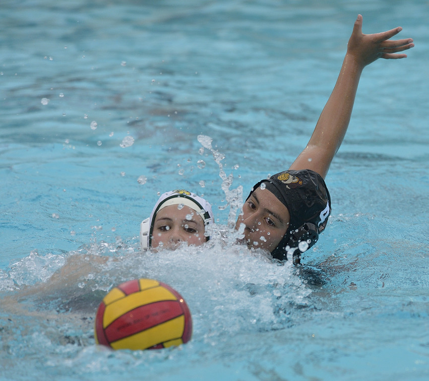 . LONG BEACH, CALIF. USA -- Wilson\'s Julie Luna (4) and Poly\'s Savannah Steffen (15) battle for the ball in Long Beach, Calif., on February 7, 2013. Wilson defeated Poly, 6 to 5, to win the Moore League. Photo by Jeff Gritchen / Los Angeles Newspaper Group